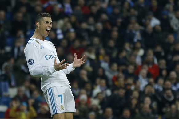 Real Madrid's Cristiano Ronaldo reacts after missing a chance to score during the Champions League Group H soccer match between Real Madrid and Borussia Dortmund at the Santiago Bernabeu stadium in Madrid, Spain, Wednesday, Dec. 6, 2017. (AP Photo/Francisco Seco)