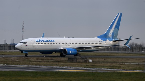 epa08943477 A Pobeda airlines plane, in which Russian opposition leader Alexei Navalny and his wife Yulia Navalnaya are to fly to Moscow, arrives at the Berlin Brandenburg International Airport BER in Schoenefeld, Germany, 17 January 2021. Navalny plans to return to Russia on a scheduled flight to Moscow later in the afternoon on 17 January. He was treated at the Charite hospital in Berlin since 22 August 2020 for being poisoned with a nerve agent from the Novichok group and was discharged from acute inpatient care on 22 September 2020.  EPA/FILIP SINGER