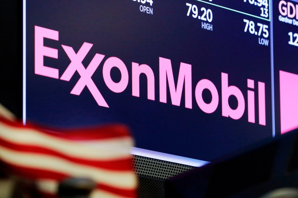 FILE - In this April 23, 2018, file photo, the logo for ExxonMobil appears above a trading post on the floor of the New York Stock Exchange.  Profits fell at Exxon Mobil, Friday, May 1, 2020, during the first quarter as the global pandemic began to erode oil demand. The Irving, Texas oil giant lost $610 million in the first quarter, down 126% from the same time last year.(AP Photo/Richard Drew, File) ExxonMobil
