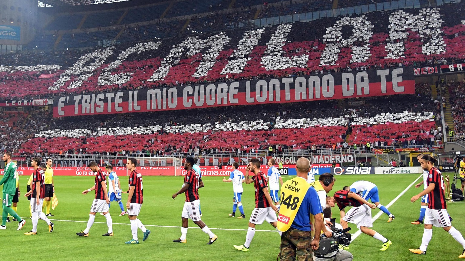 The stadium is crowded with some 65,000 fans as AC Milan and U Craiova enter the field for an Europa League third qualifying round, second leg, soccer match at the San Siro stadium in Milan, Italy, Thursday, Aug. 3, 2017. (Daniel Dal Zennaro/ANSA via AP)