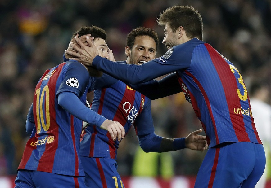 epa05837433 FC Barcelona's Lionel Messi (L) jubilates a goal with teammates Gerard Pique (R) and Neymar (C) during the UEFA Champions League Round of 16, second leg soccer match between FC Barcelona and Paris Saint-Germain at Camp Nou stadium in Barcelona, Spain, 08 March 2017.  EPA/ANDREU DALMAU