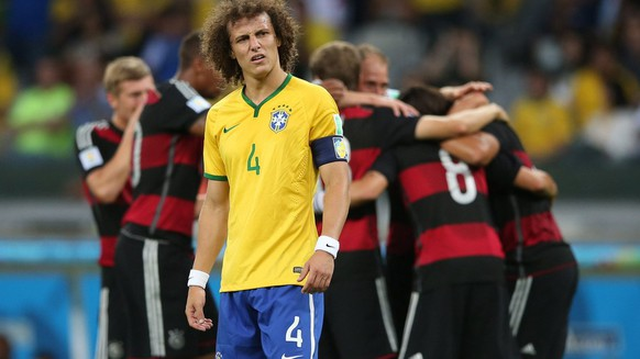 epa04306223 Brazil's captain David Luiz reacts while German player a goal during the FIFA World Cup 2014 semi final match between Brazil and Germany at the Estadio Mineirao in Belo Horizonte, Brazil, 08 July 2014. (KEYSTONE/EPA/Fernando Bizerra Jr.)