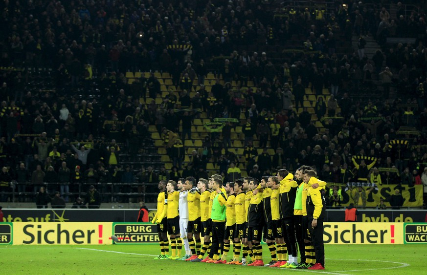 Football Soccer - Borussia Dortmund v FSV Mainz 05 - German Bundesliga - Signal Iduna Park , Dortmund, 13/03/16  The team of Borussia Dortmund commemorates a supporter, who died during the match in the stadiumREUTERS/Ina Fassbender   DFL RULES TO LIMIT THE ONLINE USAGE DURING MATCH TIME TO 15 PICTURES PER GAME. IMAGE SEQUENCES TO SIMULATE VIDEO IS NOT ALLOWED AT ANY TIME. FOR FURTHER QUERIES PLEASE CONTACT DFL DIRECTLY AT + 49 69 650050