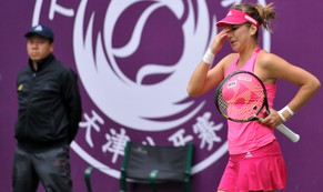 In this photo provided by China's Xinhua News Agency, Belinda Bencic of Switzerland reacts during the women's singles final against Alison Riske of the United States at the Tianjin Open tennis tournament in Tianjin, northern China, Sunday, Oct. 12, 2014.  (AP Photo/Xinhua, Yue Yuewei) NO SALES