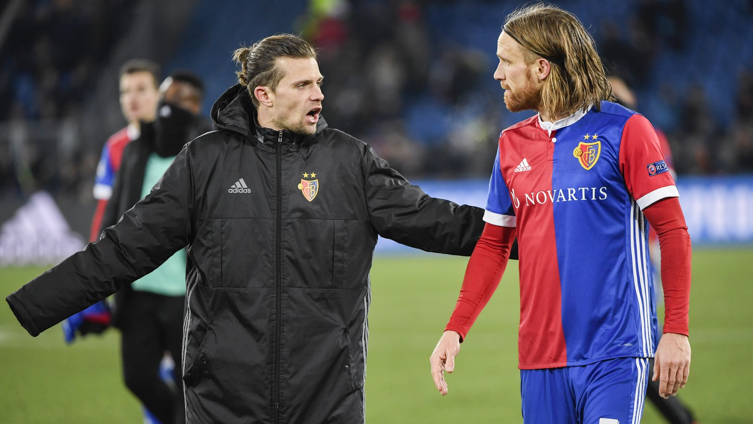 Basel's Valentin Stocker, left, and Michael Lang show dejection after the UEFA Champions League round of sixteen first leg soccer match between Switzerland's FC Basel 1893 and England's Manchester City FC in the St. Jakob-Park stadium in Basel, Switzerland, on Tuesday, February 13, 2018. (KEYSTONE/Georgios Kefalas)