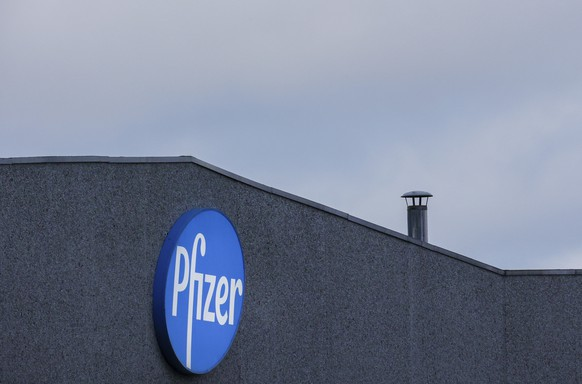 A general view of the signage at Pfizer Manufacturing plant in Puurs, Belgium, on Friday, Dec. 4, 2020. British officials on Wednesday authorized a COVID-19 vaccine for emergency use, greenlighting the world's first shot against the virus that's backed by rigorous science and taking a major step toward eventually ending the pandemic. (AP Photo/Olivier Matthys)