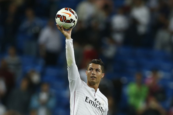 FILE -In this Sept. 23, 2014 file photo Real's Cristiano Ronaldo holds the ball as he celebrates his four goals during a Spanish La Liga soccer match between Real Madrid and Elche at the Santiago Bernabeu stadium in Madrid, Spain. Forwards Cristiano Ronaldo of Portugal and Lionel Messi of Argentina are finalists for the men's honor along with German goalkeeper Manuel Neuer, FIFA said Monday, Dec. 1, 2014. Ronaldo won in 2008 and 2013, while Messi won four in a row from 2009-12 (AP Photo/Andres Kudacki, file)
