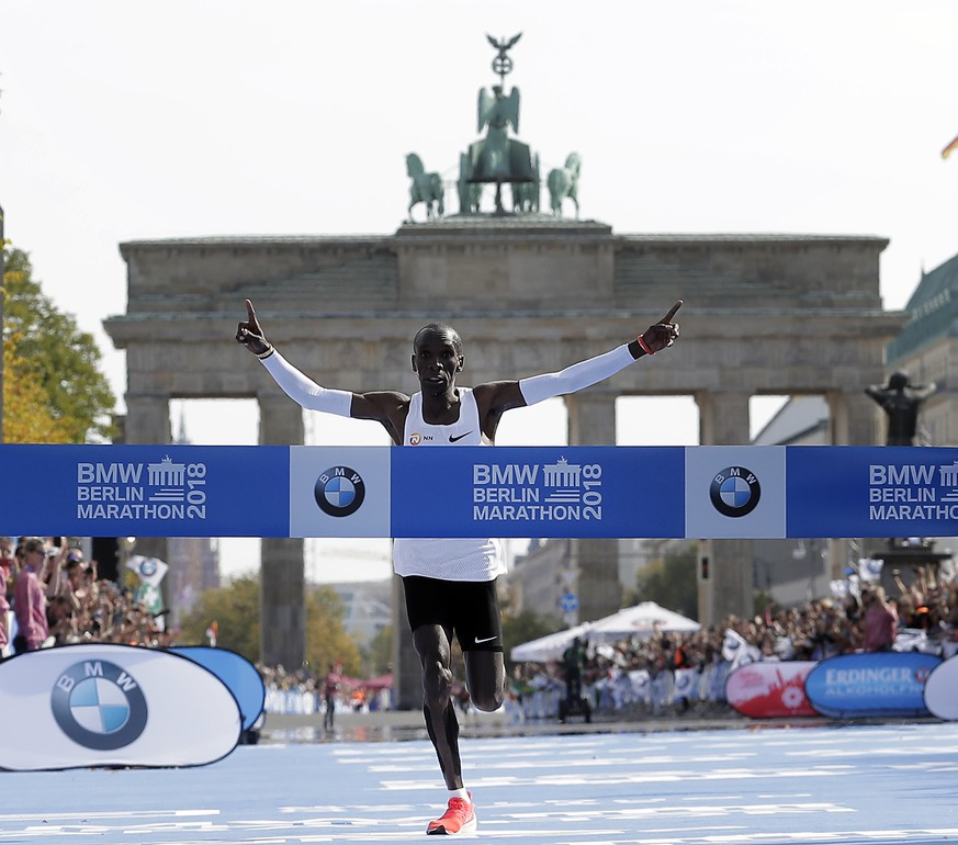 Eliud Kipchoge runs to win the 45th Berlin Marathon in Berlin, Germany, Sunday, Sept. 16, 2018. Eliud Kipchoge set a new world record in 2 hours 1 minute 40 seconds. (AP Photo/Michael Sohn)