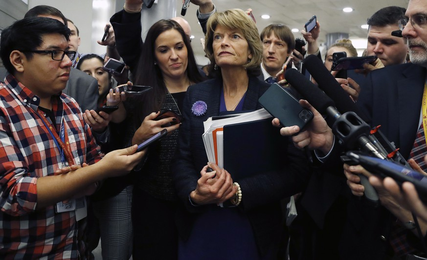 Sen. Lisa Murkowski, R-Alaska, walks with reporters as in the basement of the U.S. Capitol in Washington, Thursday, Jan. 30, 2020, while leaving at the end of a session in the impeachment trial of President Donald Trump on charges of abuse of power and obstruction of Congress. (AP Photo/Julio Cortez)