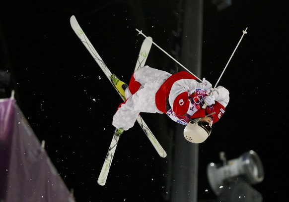 Canada's Mikael Kingsbury performs a jump during the men's freestyle skiing moguls finals at the 2014 Sochi Winter Olympic Games in Rosa Khutor, February 10, 2014.                REUTERS/Mike Blake (RUSSIA  - Tags: SPORT OLYMPICS SPORT SKIING TPX IMAGES OF THE DAY)