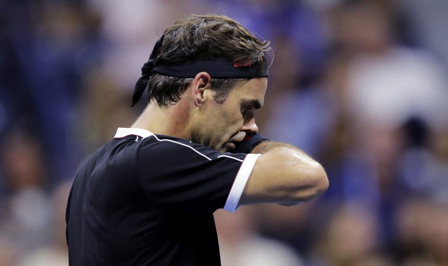 Roger Federer, of Switzerland, reacts after missing a point during the fifth set against Grigor Dimitrov, of Bulgaria, during the quarterfinals of the U.S. Open tennis tournament Tuesday, Sept. 3, 2019, in New York. (AP Photo/Charles Krupa) Roger Federer