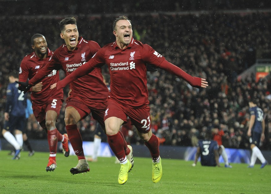 Liverpool's Xherdan Shaqiri, right, celebrates after scoring his side's third goal during the English Premier League soccer match between Liverpool and Manchester United at Anfield in Liverpool, England, Sunday, Dec. 16, 2018. (AP Photo/Rui Vieira)