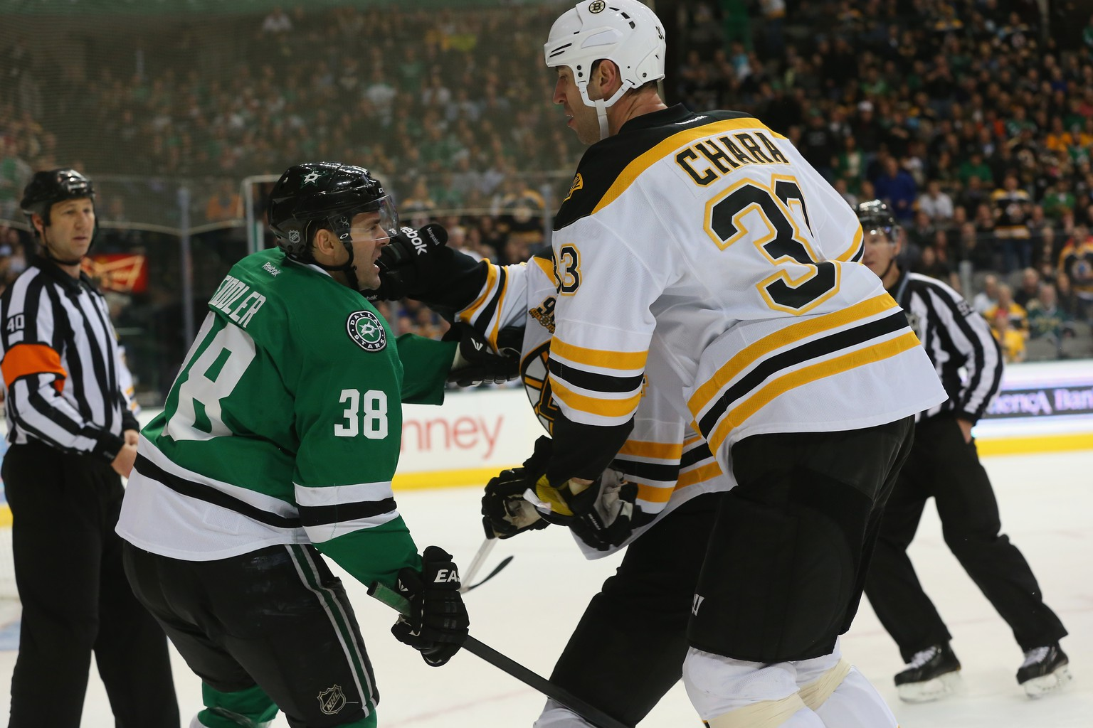 DALLAS, TX - JANUARY 16:  Vernon Fiddler #38 of the Dallas Stars fights with Adam McQuaid #54 and Zdeno Chara #33 of the Boston Bruins in the first period at American Airlines Center on January 16, 2014 in Dallas, Texas.  (Photo by Ronald Martinez/Getty Images)