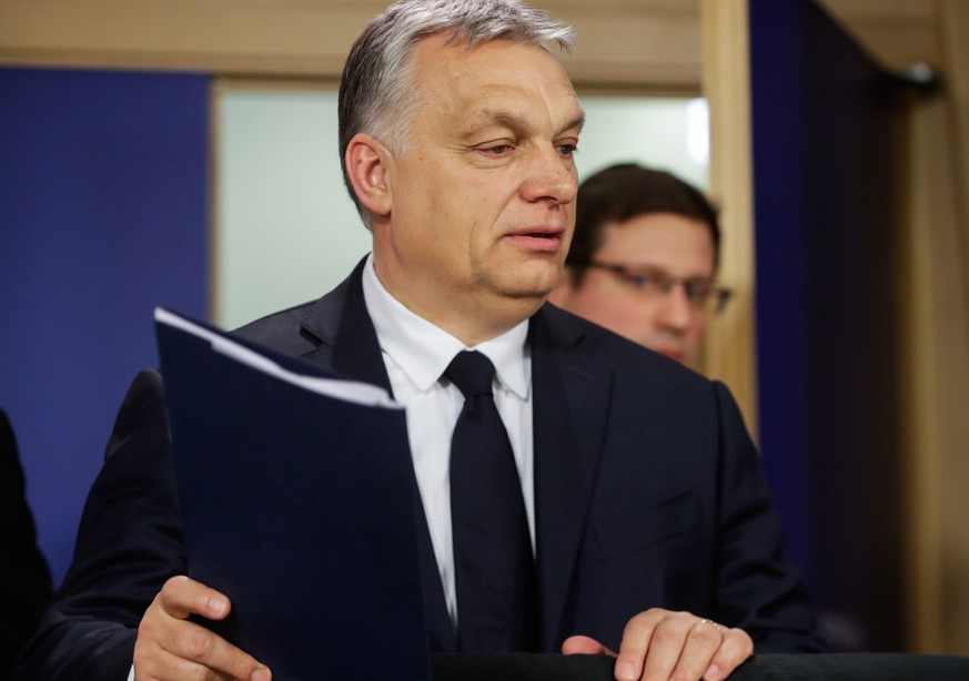 epa07451442 Hungarian Prime Minister Viktor Orban gives a press conference at the end of the European People's Party (EPP) Political Assembly at the European Parliament in Brussels, Belgium, 20 March 2019. The Fidesz party of Hungarian Prime Minister Viktor Orban has been temporary suspended by EPP.  EPA/STEPHANIE LECOCQ