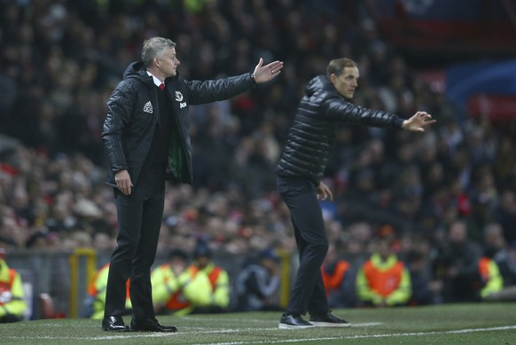 Manchester United's manager Ole Gunnar Solskjaer, left andParis Saint Germain's coach Thomas Tuchel gesture to their players from the sidelines during the Champions League round of 16 soccer match between Manchester United and Paris Saint Germain at Old Trafford stadium in Manchester, England, Tuesday, Feb. 12,2019.(AP Photo/Dave Thompson)