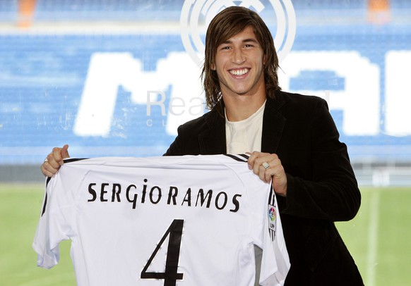 Real Madrid's new defender Sergio Ramos shows his shirt during the official presentation for the Spanish soccer club, Madrid, Thursday Sept. 8, 2005. Ramos, who has signed an eight-year contract, is Europe's third most expensive offseason transfer, after Chelsea's Shaun Wright-Phillips and Michael Essien. (AP Photo/Bernat Armangue)