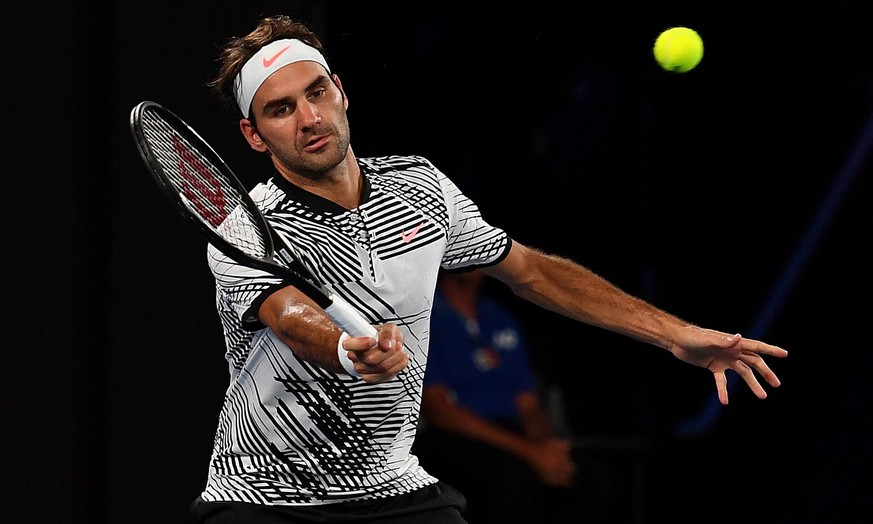 epa05721656 Roger Federer of Switzerland in action against Juergen Melzer of Austria during their Men's Singles first round match of the Australian Open Grand Slam tennis tournament in Melbourne, Australia, 16 January 2017.  EPA/TRACEY NEARMY  AUSTRALIA AND NEW ZEALAND OUT