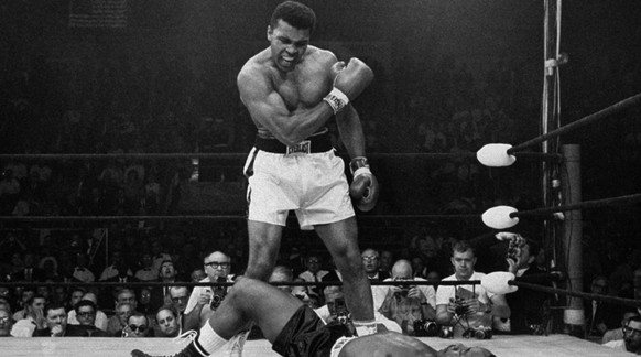 FILE - In this May 25, 1965 file photo, heavyweight champion Muhammad Ali stands over fallen challenger, Sonny Liston, shortly after dropping him with a short hard right to the jaw in Lewiston, Maine. In 1964 he changed his name from Cassius Clay and adopted his Muslim name. (AP Photo/John Rooney)
