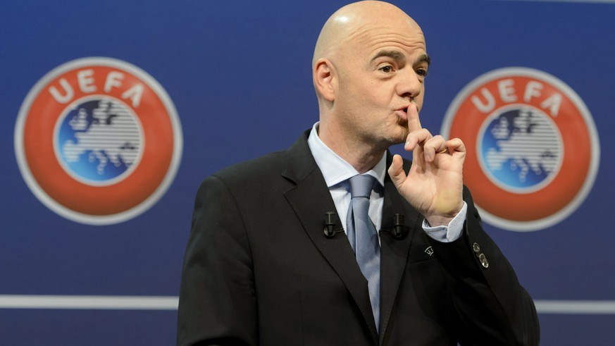 epa05246498 (FILE) A file picture dated 18 October 2015 of then UEFA General Secretary Gianni Infantino, reacts during the draw for the play-off matches for UEFA EURO 2016 at the UEFA Headquarters, in Nyon, Switzerland. Swiss federal police raided UEFA offices in Nyon 06 April 2015 in relation to Tv contract details leaked in the Panama Papers.  EPA/JEAN-CHRISTOPHE BOTT