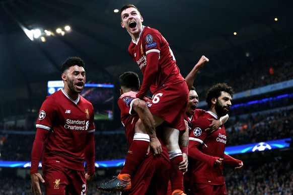epa06660262 Liverpool's Mohamed Salah (R) celebrates with his teammates after scoring the 1-1 equalizer during the UEFA Champions League quarter final second leg match between Manchester City and FC Liverpool in Manchester, Britain, 10 April 2018.  EPA/Nigel Roddis