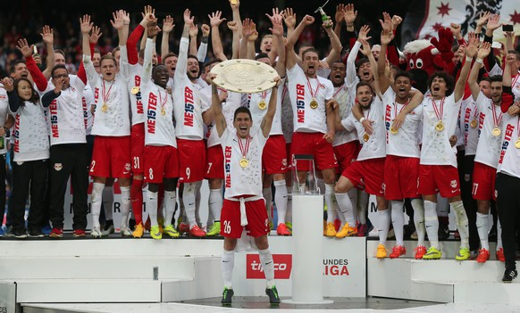 SALZBURG, AUSTRIA - MAY 24: Captain Jonatan Soriano of Salzburg celebrates with his team and the trophy for winning the Austrian Soccer Championship after the tipico Bundesliga match between RB Salzburg and Wolfsberger AC at Red Bull Arena on May 24, 2015 in Salzburg, Austria.  (Photo by Andreas Schaad/Bongarts/Getty Images)