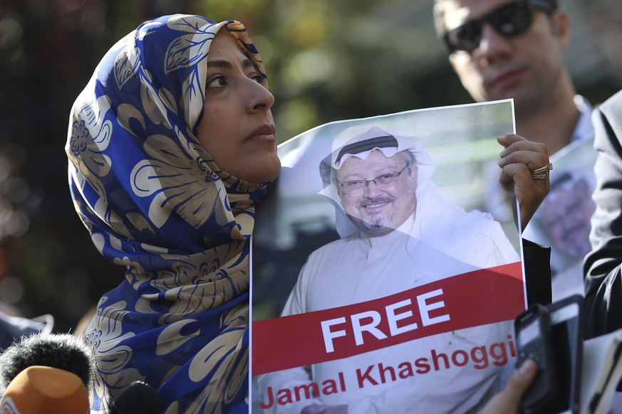 FILE - In this Friday, Oct. 5, 2018 file photo, Tawakkol Karman, the Nobel Peace Prize laureate for 2011 holds a picture of missing Saudi writer Jamal Khashoggi as she speaks to journalists near the Saudi Arabia consulate, in Istanbul, Turkey. Khashoggi was a Saudi insider. He rubbed shoulders with the Saudi royal family and supported its efforts to nudge the entrenched ultraconservative clerics to accept reforms. He was a close aide to the kingdom's former spy chief and was a leading voice in the country's prominent dailies. In a dramatic twist of fate, Khashoggi disappeared on Tuesday, Oct. 2, 2018, after visiting his country's consulate in Istanbul and may have been killed there. (AP Photo/Emrah Gurel, File)