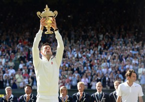 epaselect epa04302880 Novak Djokovic of Serbia holds the championship trophy following his win over Roger Federer of Switzerland in the men's singles final of the Wimbledon Championships at the All England Lawn Tennis Club, in London, Britain, 06 July 2014.  EPA/ANDY RAIN