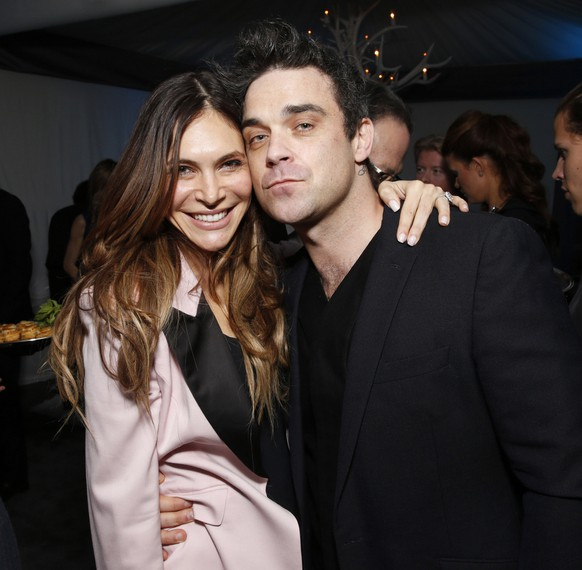 Ayda Field and Robbie Williams attend a Grammy Party hosted by Lucian Grainge on Sunday, Feb. 10, 2013 in Los Angeles. (Photo by Todd Williamson/Invision/AP)