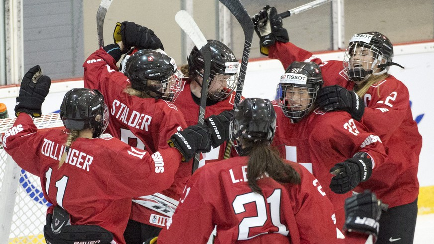 Team Switzerland players celebrate after defeating Japan 4-2 at the women's world hockey championships Monday, March 28, 2016 in Kamloops, Canada. (Ryan Remiorz/The Canadian Press via AP)
