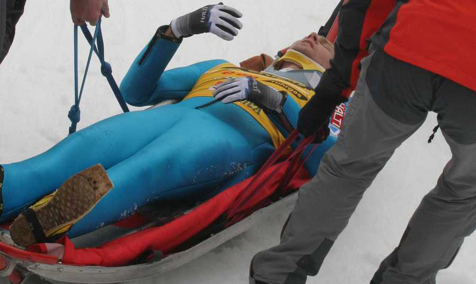 Overall World Cup  winner Janne Ahonen of Finland is carried away after a bad landing during the World Cup Ski Jumping competition in Planica, Slovenia, Sunday, March 20, 2005. Ahonen jumped 240 meters, but crashed while landing. (AP Photo/Filip Horvat)