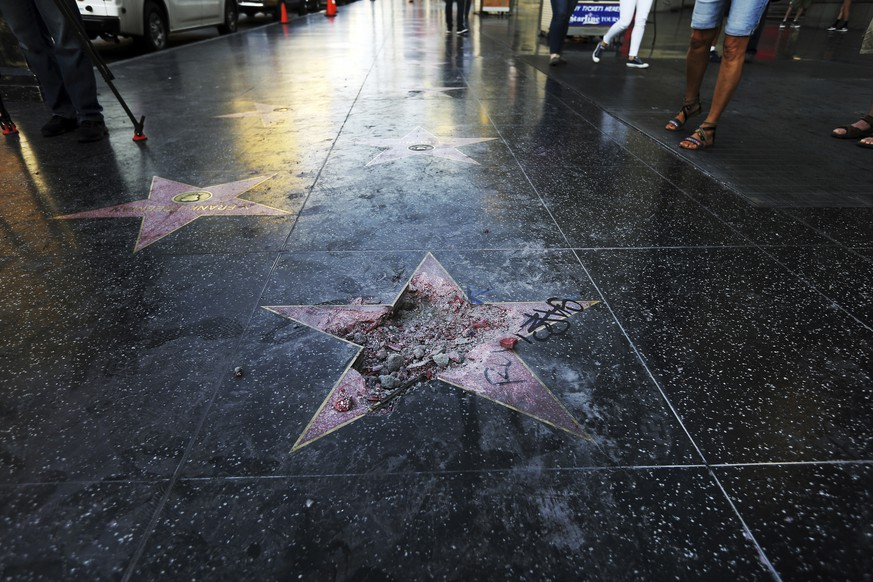 FILE - This Wednesday, July 25, 2018 file photo shows Donald Trump's vandalized star on the Hollywood Walk of Fame in Los Angeles. On Friday, Aug. 3, 2018, The Associated Press has found that stories circulating on the internet that the man arrested for destroying the star will lose his right to vote for the rest of his life, are untrue. (AP Photo/Reed Saxon)