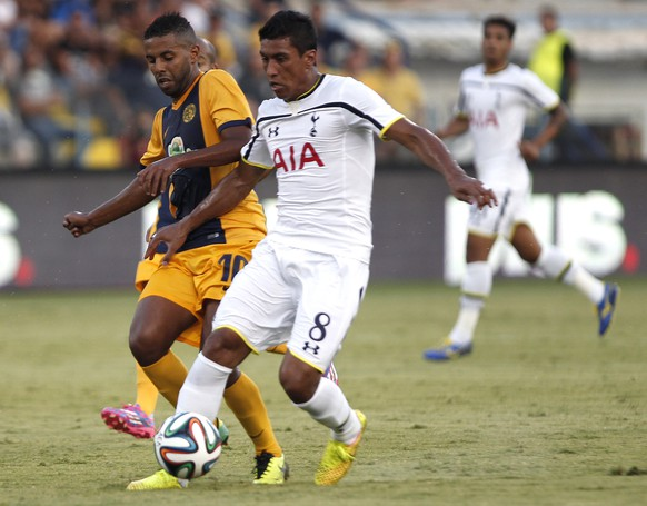 Diego Barcelos, left,  of AEL in action with Paulinho of Tottenham during their Europa League play-offs first leg soccer match at Antonis Papadopoulos stadium in Larnaca, Cyprus, Thursday, Aug. 21, 2014. (AP Photo/Petros Karadjias)