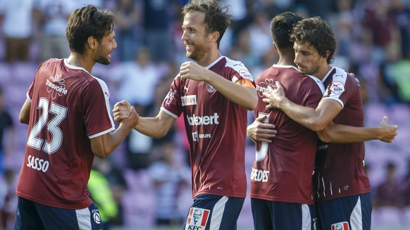 Servette's players defender Vincent Sasso, left, defender Anthony Sauthier, 2nd left, midfielder Boris Cespedes, 2nd right, and midfielder Miroslav Stevanovic, right, celebrate their victory after beating Luzern, during the Super League soccer match of Swiss Championship between Servette FC and FC Luzern, at the Stade de Geneve stadium, in Geneva, Switzerland, Sunday, August 4, 2019. (KEYSTONE/Salvatore Di Nolfi)