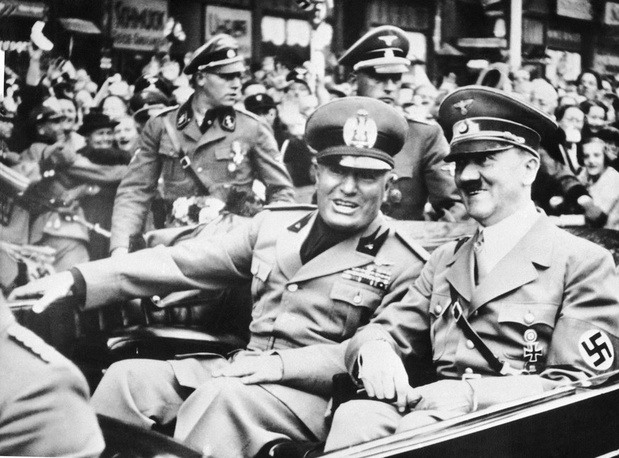 FILE - File photo dated Sept. 28, 1938 showing Italian dictator Benito Mussolini, at left in foreground, and  Nazi leader Adolf Hitler, at right, taken just before the four power conference in Munich, Germany. As a gesture of friendship, Hitler met  Mussolini with his car at the Italo-German frontier. Benito Mussolini was a fierce anti-Semite, who proudly said that his hatred for Jews preceded Adolf Hitler's and vowed to