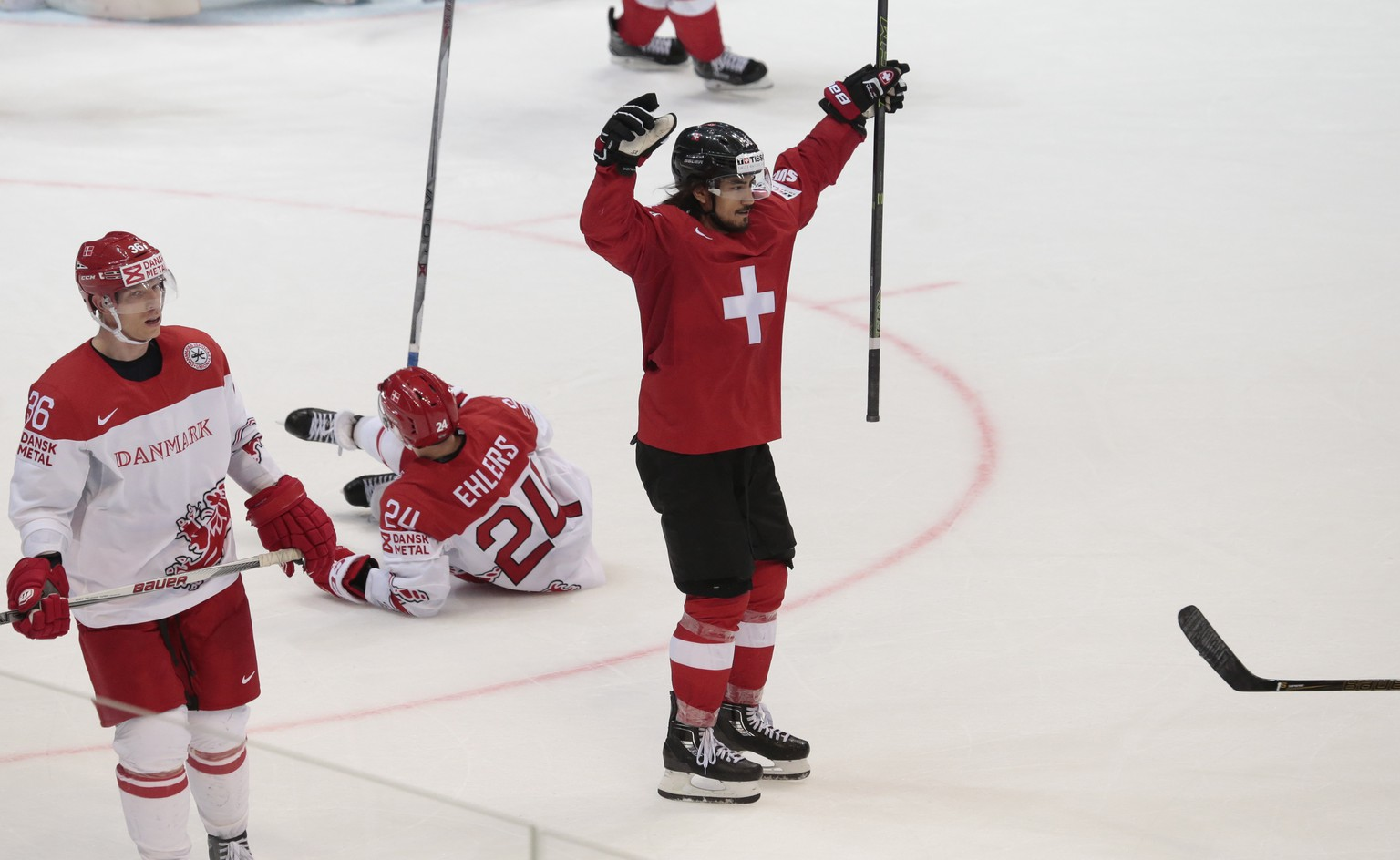 Switzerland's Eric Blum reacts after scoring