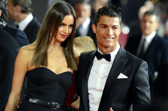 FILE - This is a Monday, Jan. 7, 2013 file photo of Portugal's Cristiano Ronaldo, right, as he  arrives with his girlfriend Irina Shayk,  on the red carpet prior to the FIFA Ballon d'Or Gala 2013 held at the Kongresshaus in Zurich, Switzerland.  Cristiano Ronaldo confirmed Tuesday Jan. 20, 2015 that he has broken up with his longtime girlfriend, Russian model Irina Shayk. (AP Photo/Keystone/Walter Bieri)