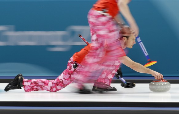 Norway's skip Thomas Ulsrud prepares to push the stone during their men's curling match against Japan at the 2018 Winter Olympics in Gangneung, South Korea, Wednesday, Feb. 14, 2018. (AP Photo/Aaron Favila)