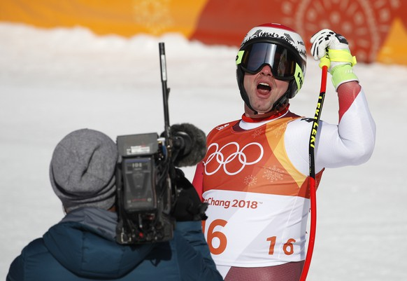 Switzerland's Beat Feuz reacts after finishing the men's super-G at the 2018 Winter Olympics in Jeongseon, South Korea, Friday, Feb. 16, 2018. (AP Photo/Christophe Ena)