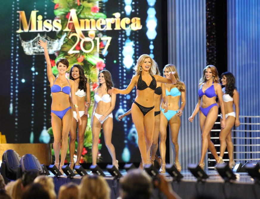 The contestants walk on stage during the Lifestyle and Fitness portion of the first night of Miss America Preliminaries, Tuesday, Sept. 6, 2016, in Atlantic City. Miss District of Columbia and Miss Tennessee won the first night of preliminaries in the Miss America competition Tuesday. Cierra Jackson, Miss District of Columbia, won the swimsuit competition, while Miss Tennessee, Grace Burgess, won the talent competition, singing the Eagles' classic