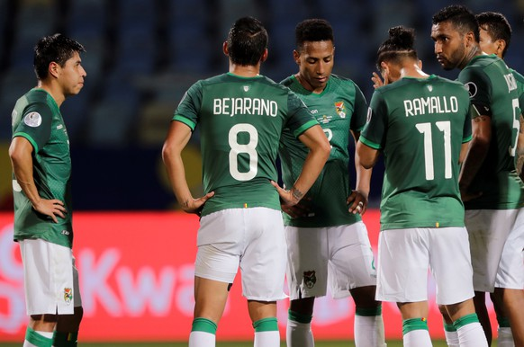 epa09272088 Bolivia players react after losing at the end of a Copa America soccer match between Paraguay and Bolivia at Estadio Olimpico Pedro Ludovico in Goiania, Brazil, 14 June 2021.  EPA/Joedson Alves