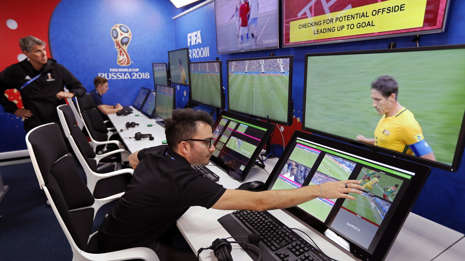 epaselect epa06795869 A view of the video assistant referee (VAR) video operation room (VOR) of the 2018 World Cup International Broadcast Centre (IBC) in Moscow, Russia, 09 June 2018. The FIFA World Cup 2018 will take place in Russia from 14 June until 15 July 2018.  EPA/YURI KOCHETKOV