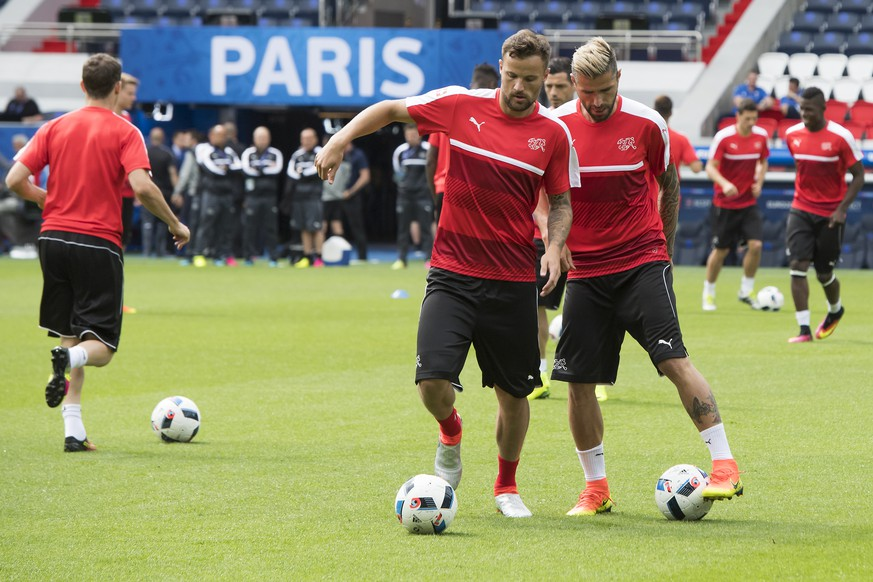Swiss forward Haris Seferovic,center, and Swiss midfielder Valon Behrami, right, in action during a team's training session, at the Parc des Princes stadium, in Paris, France, Tuesday, June 14, 2016. The Swiss national soccer team will play Romania in Group A on Wednesday during the UEFA EURO 2016 soccer championship in France. (KEYSTONE/Jean-Christophe Bott)