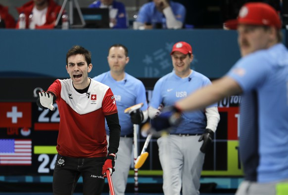 Switzerland's skip Peter de Cruz, left, makes a call during a men's curling match against United States at the 2018 Winter Olympics in Gangneung, South Korea, Tuesday, Feb. 20, 2018. (AP Photo/Natacha Pisarenko)