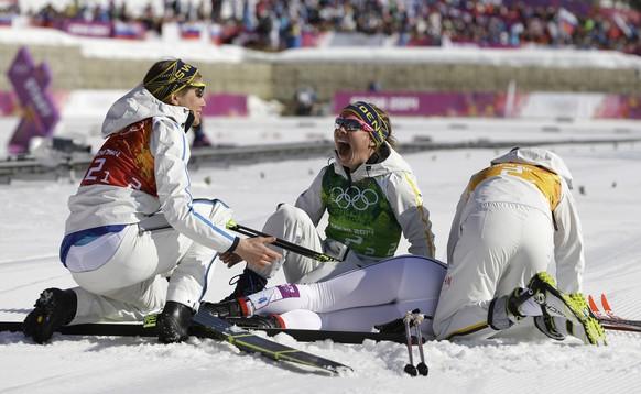 Sweden's women's 4x5K cross-country relay team celebrate winning the gold during the women's 4x5K cross-country relay at the 2014 Winter Olympics, Saturday, Feb. 15, 2014, in Krasnaya Polyana, Russia. (AP Photo/Kirsty Wigglesworth)