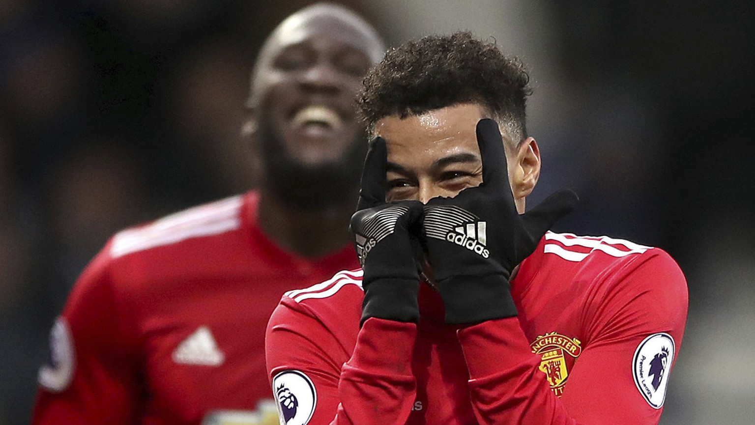 Manchester United's Jesse Lingard, right, celebrates scoring against West Bromwich Albion with teammate Romelu Lukakus during their English Premier League soccer match at The Hawthorns, West Bromwich, England, Sunday Dec. 17, 2017. (Nick Potts/PA via AP)