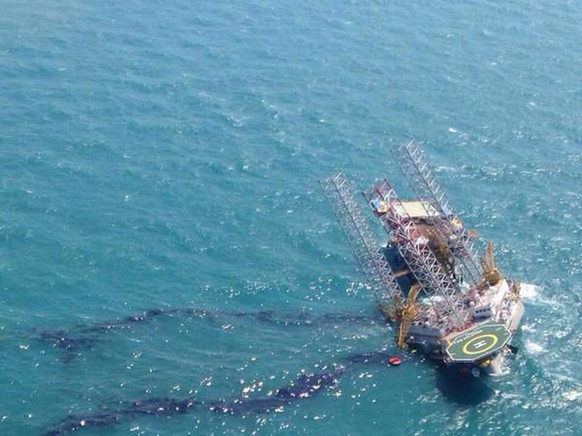 epa04734577 Photo shows the oil exploration rig Troll Solution tilting after an accident while preparing for the maintenance of works near the coast of Campeche state, Mexico, 05 May 2015. According sources of state Petroleos Mexicano (Pemex) company, two men died after the platform tilted during work preparations.  EPA/José Luis Hernández