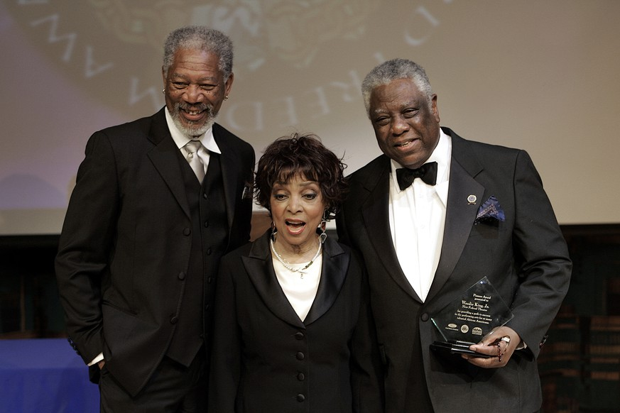 FILE - In this May 15, 2006 file photo shows actors Morgan Freeman, from left, Ruby Dee, accepting for her husband Ossie Davis, awarded the 2006 Ford Freedom Award posthumously, and director Woodie King, Jr., after being honored as the 2006 Ford Freedom Award winners in Detroit.  Dee, an acclaimed actor and civil rights activist whose versatile career spanned stage, radio television and film, has died at age 91, according to her daughter. Nora Davis Day told The Associated Press on Thursday, June 11, 2014, that her mother died at home at New Rochelle, New York, on Wednesday night.  (AP Photo/Paul Sancya, file)