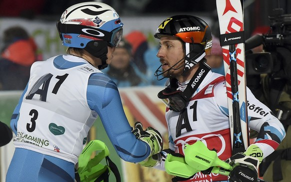 Norway's Henrik Kristoffersen, left, is congratulated by second placed Austria's Marcel Hirscher after winning an alpine ski, men's World Cup slalom, in Schladming, Austria, Tuesday, Jan. 23, 2017. (AP Photo/Marco Tacca)