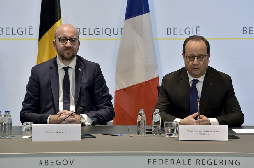 Belgium's Prime Minister Charles Michel (L) attends a joint news conference with France's President Francois Hollande in Brussels, Belgium, March 18, 2016. Salah Abdeslam, the most-wanted fugitive from November's Paris attacks, was arrested after a shootout with police in Brussels on Friday, Belgium's prime minister said.  REUTERS/Eric Vidal      TPX IMAGES OF THE DAY