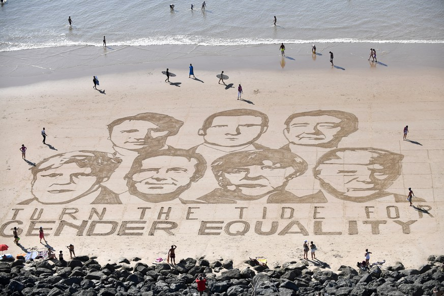 epa07788456 A sand art performance by French artist Sam Dougados representing G7 leaders (L-R, Boris Johnson, Justin Trudeau, Giuseppe Conte, Emmanuel Macron, Angela Merkel, Shinzo Abe and Donald Trump) for ..the ONE Campaign to promote gender equality is displayed at the Plage de la CÃ ?te des Basques on the eve of the G7 summit in Biarritz, France, 23 August 2019. The G7 Summit runs from 24 to 26 August in Biarritz.  EPA/JULIEN DE ROSA